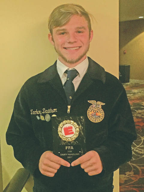 Zach Davidson is shown with the seventh place plaque he earned at the Big E Dairy Handler's Contest.