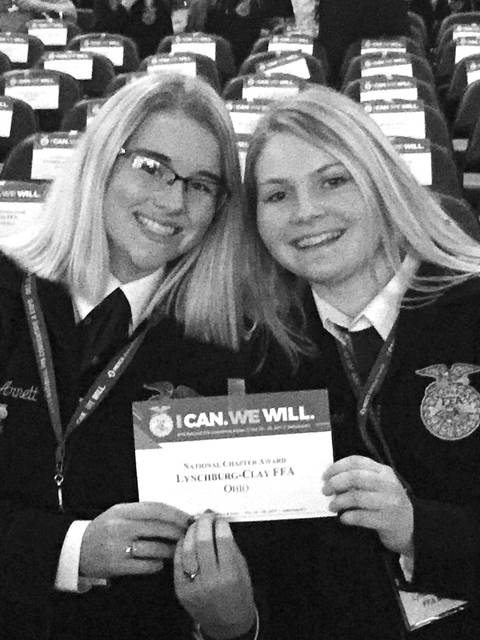 Kelsey Arnett and Elizabeth Zaremba accept the 3-Star National Chapter Award on behalf of the Lynchburg-Clay FFA Chapter at the 90th annual National FFA Convention and Expo in Indianapolis.