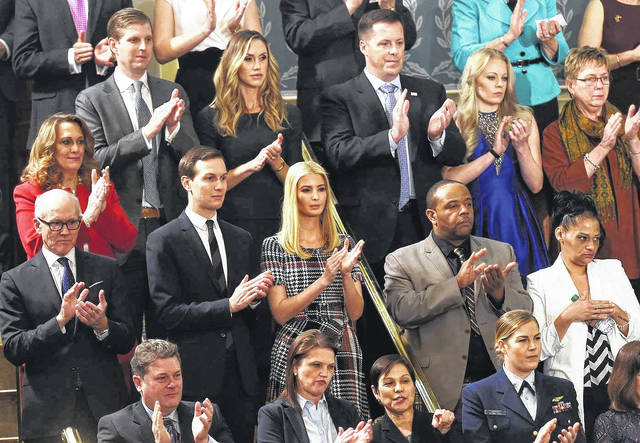 Hillsboro High School graduate Jim Winner is shown top row center in dark suit with blue tie, with Eric and Lara Trump to his immediate right, and Jared Kushner and Ivanka Trump just below him and to his right. Shown directly below Winner are Robert Mickens and Elizabeth Alvarado, the parents of murder victim Nisa Mickens.