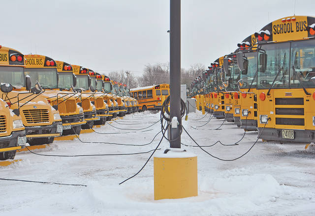 Hillsboro City Schools buses are parked at the district's bus garage Monday afternoon while plugged into engine block heaters. Transportation supervisor Ron Ward said the buses have diesel engines which are hard to start in the cold. He said that in cold weather, power comes on to the heaters around 3 a.m. and goes off about 6 a.m. when drivers are ready to hit the road.