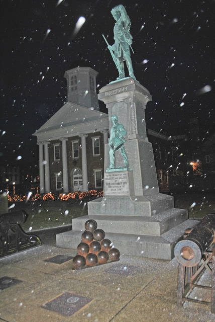 The freezing rain weather forecasters promised glistens off cannonballs in front of the Civil War monument on the Highland County Courthouse lawn in Hillsboro as sleet was starting to come down around 6 p.m. Friday.