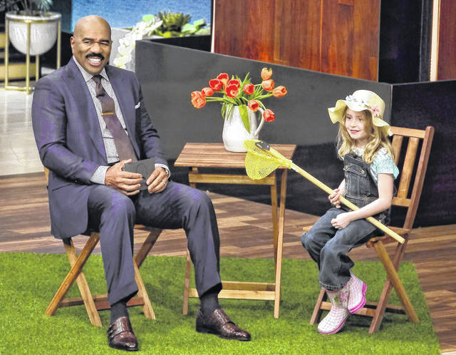 Young Clinton Countian Emily Webb, right, is shown with TV host Steve Harvey.
