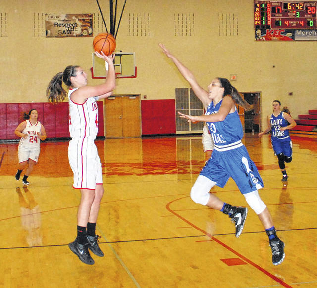 Hillsboro's Natalie Sullivan shoots a jumper over the outstretched hand of Hannah Haithcock on Wednesday at Hillsboro High School where the Lady Indians hosted the Lady Blue Lions.
