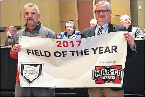 Whiteoak Wildcats head baseball coach Chris Veidt (left) is pictured holding the banner for the first annual Field of the Year with Joe Bennett, a sales representative for Mar-Co Clay, at the annual Ohio High School Baseball Coaches Association clinic.