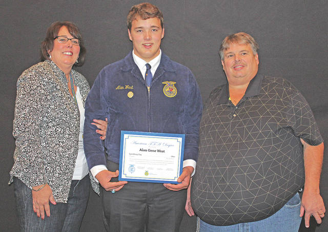 Alan West was an American Degree recipient when the Lynchburg-Clay FFA recently attended the 90th National FFA Convention and Expo in Indianapolis. He is pictured with his parents, Janet and Chris West.