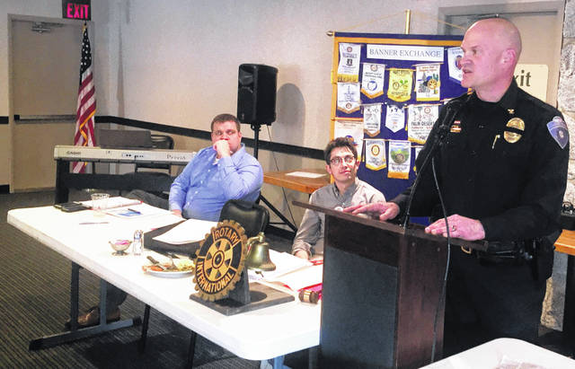 New Hillsboro Police Chief Darrin Goudy, right, addresses Hillsboro Rotarians on Tuesday as Bryan Smith, secretary, left, and Reid Sharp, president, listen at the Ponderosa Banquet Center.