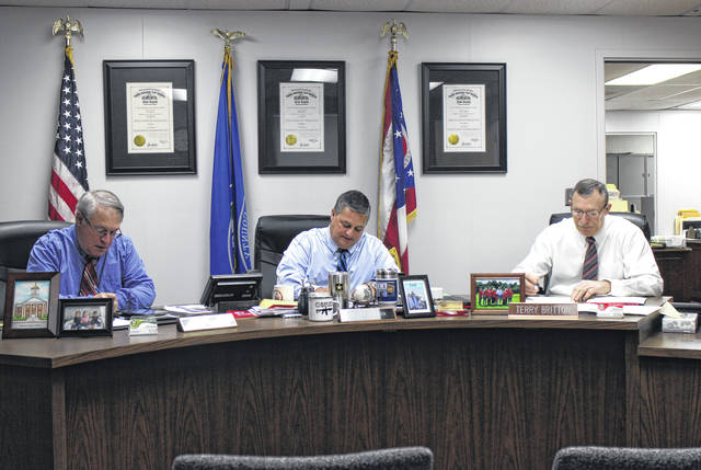 From left, Highland County Commissioners Jeff Duncan, Shane Wilkin and Terry Britton sit in session during a commissioners meeting on Wednesday.