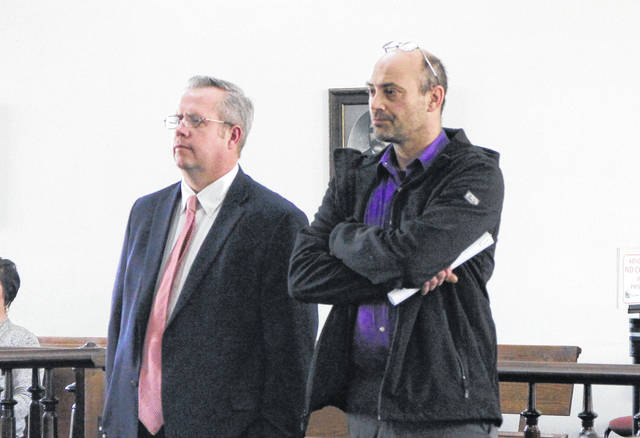 Shawn Ervin, right, stands in court Wednesday morning with defense attorney Lee Koogler.