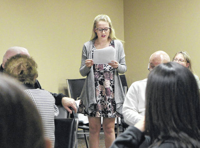 Haven Woods, a local high school student, reads an essay to the Highland County Drug Abuse Coalition at its monthly meeting on Thursday.