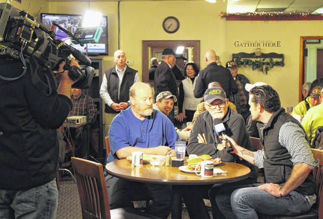 "Fox host Pete Hegseth, right, interviews local veterans Dennis Griffith, left, and Rob Moffat during Wednesday's ""Fox & Friends"" visit to Momma's West Main Cafe in Hillsboro."