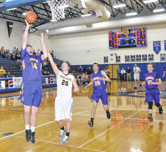 Devin Carter lay the ball in on the fast break against Miami Trace on Tuesday at Southeastern High School during the Tigers Sectional Semi-Final game against the Miami Trace Panthers.