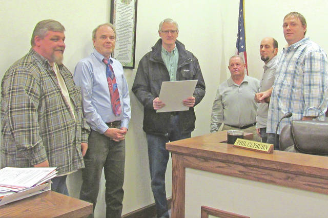 Bill Lee, center, was recognized by Greenfield Village Council on Wednesday by proclamation for his 25 years of televising the meetings on the local cable access channel. Pictured, from left, are council members Chris Borreson and Phil Clyburn, Lee, and council members Bob Bergstrom, Eric Borsini and Mark Clyburn.