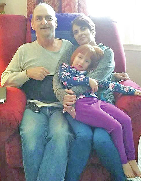 Ray and Donna Debusk are pictured with their 6-year-old granddaughter, Gloria.