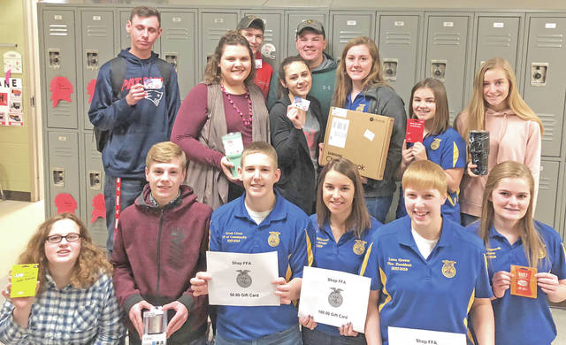 "On Feb. 22, the Hillsboro FFA rewarded its members for the annual fruit sale. This year's winners were Kirsten Harp, who won a $15 Wendy's card; while Madi Stratton, Zane Adams and Spencer Rudy each won a $10 Dairy Queen gift card. Kennedi Claycomb won a $15 Taco Bell card; Adah Caroza won a $15 Subway gift card; Nate Sexton won an FFA watch; Lana Grover won a $25 gift card the Shop FFA; Grant Crum won a $50 gift card to shop FFA; Emily Pence, Taryn Magulac and Maddy Miller each won tumblers; Bryce Stanley won a wireless speaker; Jordan Williamson won a $100 gift card to Shop FFA; and Brittany Rhoads won a Chromebook laptop. Taryn Magulac said, "" It felt great to be recognized for the hard work we have all done."" Pictured (front row, l-r) Adah Caroza, Bryce Stanley, Grant Crum, Jordan Williamson, Lana Grover and Kennedi Claycomb; (second row, l-r) Zane Adams, Emily Pence, Spencer Rudy, Madi Stratton, Nathan Sexton, Brittany Rhoads, Kirsten Harp and Taryn Magulac."