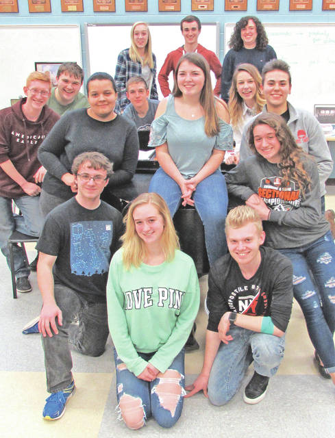 "Hillsboro High School students who perform in Saturday's ""HHS On Broadway"" show pose around a piano during rehearsal on Thursday."