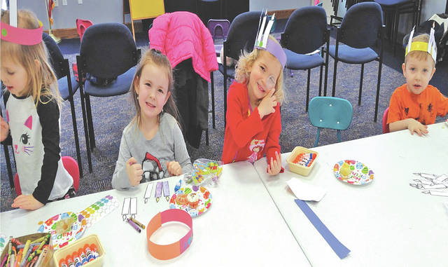 Children celebrate unbirthdays during storytime at the Greenfield Branch Library.