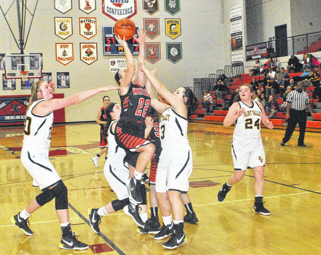 Megan Botts attempts a layup while surrounded by three Paint Valley defenders on Wednesday night at Northwest High School during the Division IV sectional girls basketball tournament.