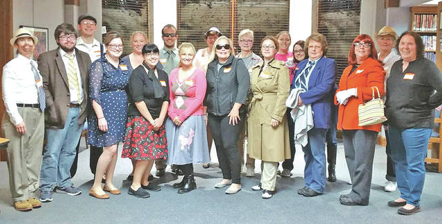 Shown are participants from a past Highland County District Library Halloween Murder Mystery Party.