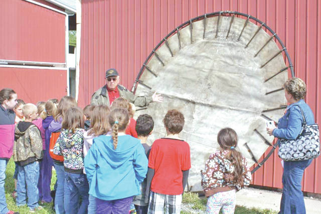 Greenfield Historical Society volunteer Paul Wisecup explains the history and use of the Browder Lifesaving Net to second-graders during their annual spring visit to the society's museums.