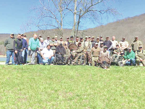 Hunters and support staff are pictured last year at Pike Lake State Park with turkeys that were bagged during the inaugural Thunder in the Hills Turkey Hunt.