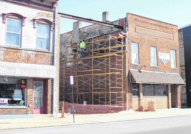 Construction crews enjoyed mild weather this week as they continued construction of a brick wall to cover the exposed side of the old Wanda's Grill building.