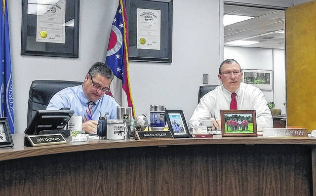 Highland County Commissioners Shane Wilkin, left, and Terry Britton discuss business items during a regular commission meeting Wednesday morning.