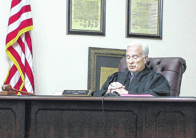 Judge Kevin Greer presides over a disposition hearing in Highland County Juvenile Court on Thursday.