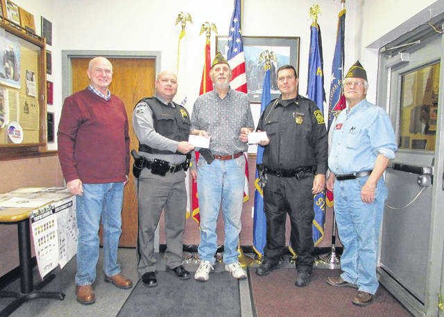 The Hillsboro VFW Post 9094 recently donated funds to the Highland Marshal's Office and the Lynchburg Police Department for new tazers for both agencies. Shown, left to right, are Lynchburg Mayor Terry Burden, Lynchburg Police Chief Richard Warner, Post Commander Rick Wilkin, Highland Marshal Pat Hendrix and Post Quartermaster Dave Pinney. The post donated $1,177 to the Highland Marshal's Office and $1,182 to the Lynchburg PD.