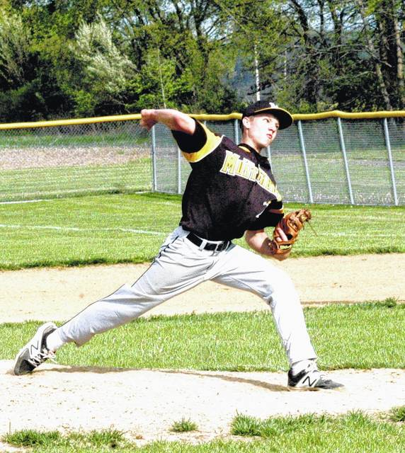 In this file photo Lynchburg-Clay junior Caden Hess tosses a pitch towards the mound in a game against the Peebles Indians.
