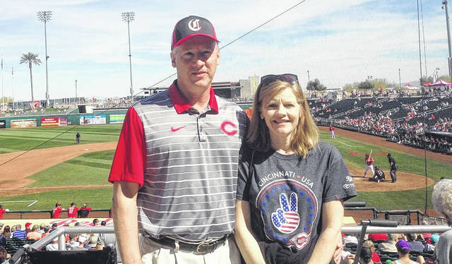 """Dave (left) and Jodi Hilliard are pictured at Goodyear Ballpark in Goodyear, Arizone on Tuesday taking in the Spring Training game between the Cincinnati Reds and the Cleveland Indians. Dave and Jodi were named the """"Fans of the game"""" and had an opportunity to win a new car if the Reds hit a grand slam against the Indians. The Hilliards formerly were teachers in the Hillsboro City School District and are now retired. Dave is the varsity girls golf coach for Hillsboro High School and is the voice of Hillsboro varsity sports for WSRW 101.5."""