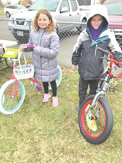 "Edgewood Manor of Greenfield held its annual Community Easter Egg Hunt on March 24. Braving the cold, wintry elements of this spring, hundreds of local children scattered, raced and gathered hundreds of eggs filled with treats and prizes. Many ticket prizes and two bicycles for each age group were donated by local businesses and individuals. ""We cannot say enough about our community support. Each year our donors go over and above efforts to make this community event a success. Kuddos to the activities department, marketing team and the entire staff at Edgewood for their personal donations, time and effort,"" said Elaine Williams, director of social services at Edgewood Manor. ""Every year our residents enjoy stuffing the candy in the eggs and watching the children scamper for the eggs. It's their way to help support our community events and paying it forward for the children."" Shown in one photo are the 7- to 8-year-old bike winners, A.J. Louk and Brylee Babbs. Not pictured are the 3 years and under bike winners, Scarlett Rain Brewer and Bradley Allen Walker. Names were not unavailable for 4 to 6 years age group. The other photo shows some of the prizes that were given away."