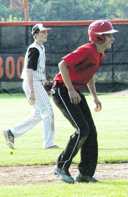 In this file photo Fairfield senior Cody Gragg takes a lead off second base during the Lions' 2017 sectional game versus the Whiteoak Wildcats at Whiteoak High School.