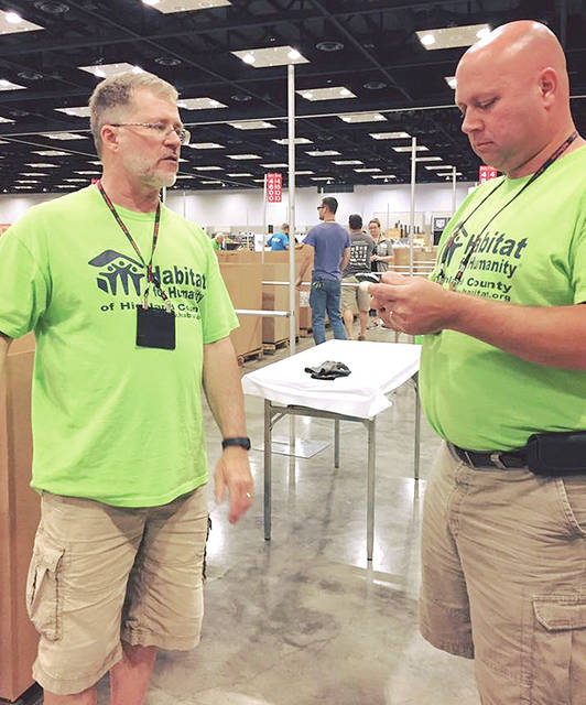 Highland County Habitat for Humanity board chairman Richard Warner, right, and board treasurer Daryl Mount are pictured at a Do It Best Home Convention where businesses donated home materials to the Habitat store in Hillsboro.
