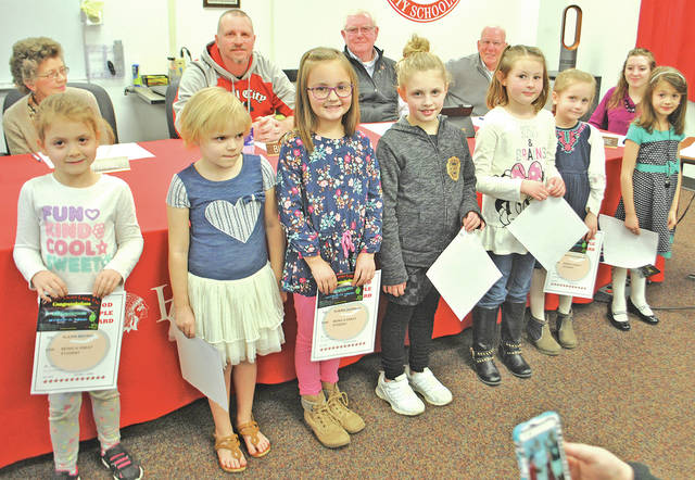 Some of the kindergarten students who were honored Wednesday at a Hillsboro Board of Education meeting are pictured. The students honored included Brynn Davis, Madlyn Vaughn, Emma Penwell, Reece Bryson, Judd McKenzie, Aubrie Jackman, Tatum Whipkey, Alexis Bryant and Jaycee Kohus. Board of education members are pictured in the background.