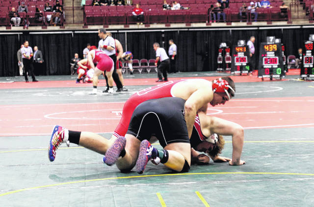 Lane Cluff of Hillsboro grapples with Bobby Grothjan of Lima Shawnee at the Schottenstein Center on Thursday night in the first round of the Consolation bracket.