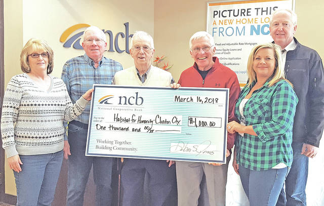 NCB recently donated $1,000 to Habitat for Humanity-Clinton County. This organization began building homes for families in need in 1994. It has built 37 homes and plans to build two homes in 2018. Pictured are NCB staff members, Cathy Collins (left) and Holly Mitchell (right) presenting a check to Habitat for Humanity representatives Wendell Compton, Len Perkins, Tom Matrka and Bob Schaad.