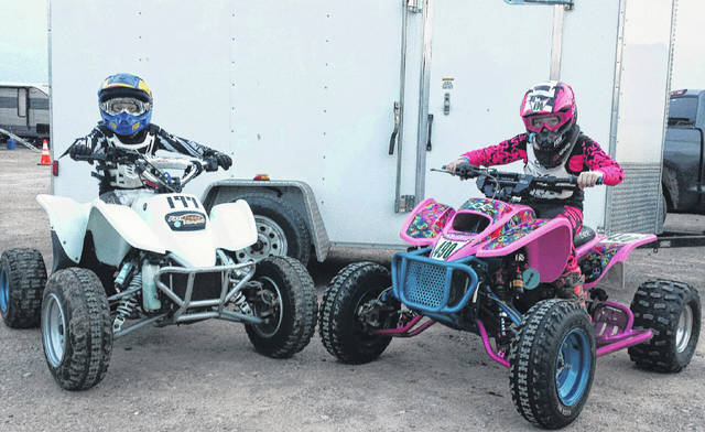 Jason Butler, left, and his aunt Sarah McKinney are pictured on their racing quads Friday in Jackson before the start of their respective races at the Battle in the Barn.