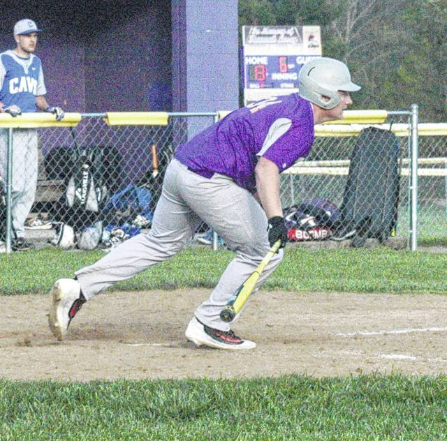 In this file photo McClain junior John Salyers begins to run after blasting a fly ball to centerfield against the Chillicothe Cavaliers at Mitchell's Park in Greenfield.