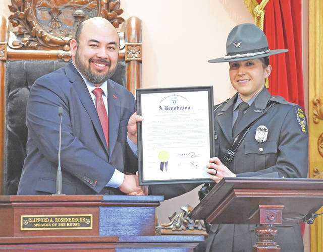 Ohio Speaker of the House Cliff Rosenberger is pictured with 2017 Ohio State Highway Patrol Trooper of the Year Brittany Noah.