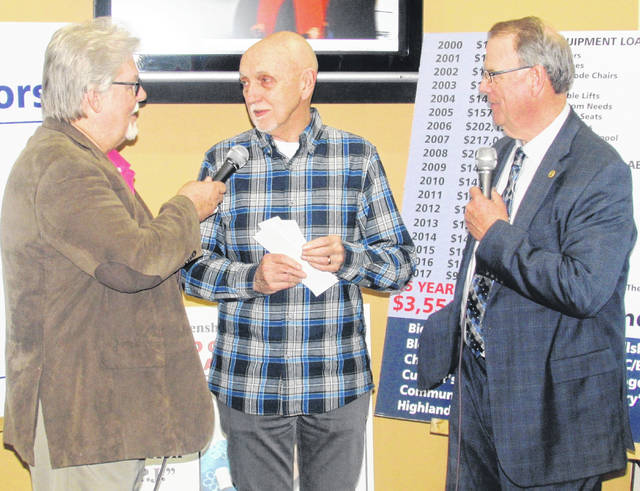 Richard Vanzant delivers a donation of $15,000 from the Cassner Foundation as he is interviewed by emcees Herb Day, left, and Rick Williams
