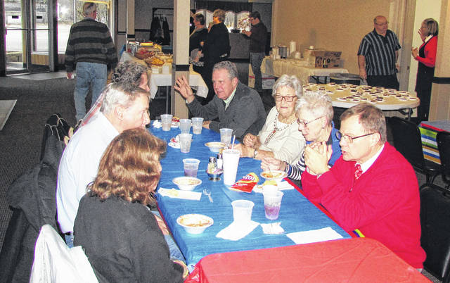 Winning recipes from the Heartland of Hillsboro chili cookoff were served by the Highland County Senior Citizens Center Thursday evening at the 14th annual Chili Supper and Dessert Auction at the Old Ponderosa Banquet Center in Hillsboro. The event serves as a fundraiser for the Ernie Blankenship Radio-Telethon for the benefit of the Highland County Society for Children and Adults, which will be held March 28. Despite the cold temperatures and scattered snow flurries, nearly $600 was raised for the chili supper, while another $1,235 was raised at the dessert auction conducted by auctioneer and Hillsboro Rotarian Rick Williams. The two winning recipes as judged in last week's competition were created by Sherryl Howell and Abby Harrison.