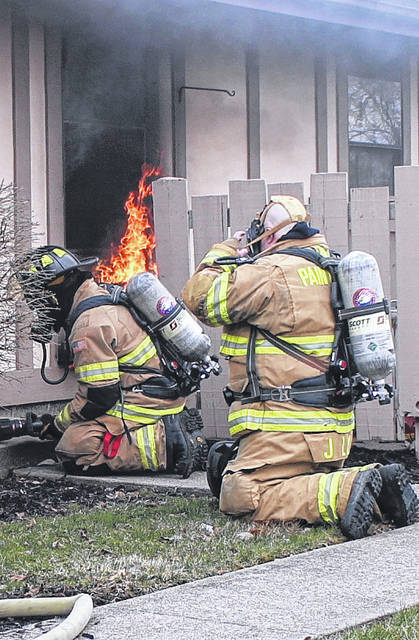 Firefighters prepare to enter an apartment on fire on Northview Drive in Hillsboro Friday morning.