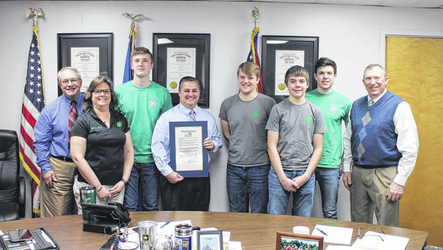 The Highland County Board of Commissioners on Wednesday declared the week of March 4-10 4-H week in Highland County. Shown from left are Highland County Commissioner Jeff Duncan, Highland County OSU Extension Director and 4-H Youth Development Educator Kathy Bruynis, Kurt Hamilton, Board of Commissioners President Shane Wilkin, Braden Heizer, Austin Leininger, Logan Cummings and commissioner Terry Britton.