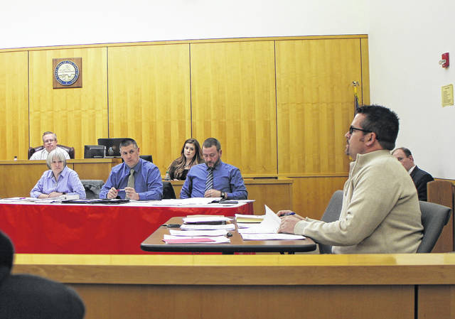 From left at the table, Hillsboro City Council members Wendy Culbreath, Brandon Leeth and Adam Wilkin listen to Safety and Service Director Mel McKenzie, right, discuss business items at a Monday council meeting. Also shown in the background are Council President Lee Koogler, left, and Clerk of Council Heather Collins.