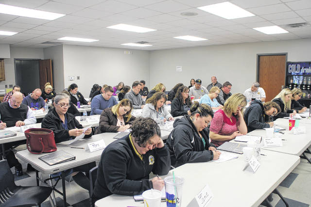 Dispatchers from around Ohio study coursework on Wednesday during a special training session at the Paint Creek Joint EMS/Fire District's Hillsboro station.