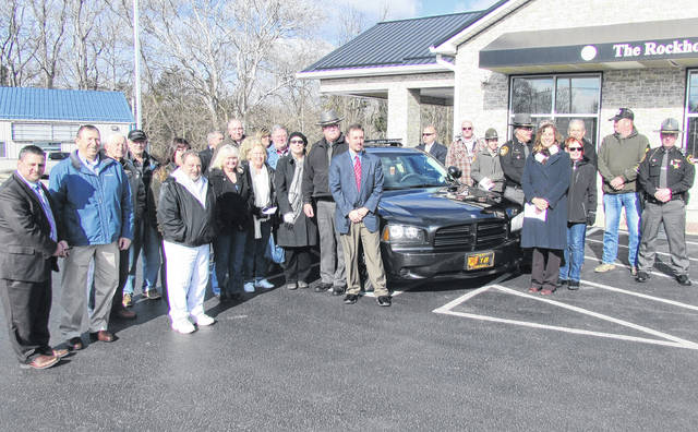 Highland County officials, Rocky Fork Lake area business owners and others are shown gathered in February 2017 for an event at the Rockhold, Brown and Company Bank branch located on North Shore Drive in celebration of a federal grant to fight crime and revitalize the Rocky Fork Lake region. After the grant hit a snag, and after months of little communication, federal grant officials agreed late this week to meet with Highland County Commissioner Shane Wilkin later this month in Washington.