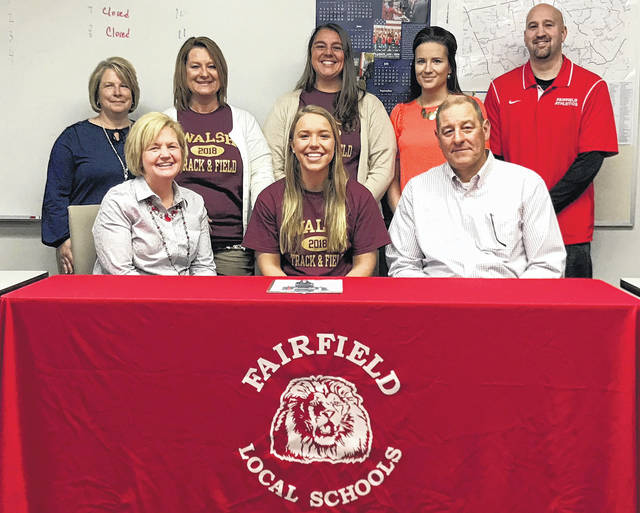 Fairfield senior Blake Adams signed her national letter of intent to attend Walsh University as a track and field athlete today. At Fairfield, Blake has been a four year athlete in volleyball, basketball and track and field while maintaining a 3.895 Cumulative GPA. Pictured back row (l-r): Deborah Mangus, Keshia McCoy, Megan Young, and Chad Hamilton. Front row (l-r): Kim Adams(mother), Blake and Craig Adams(father).