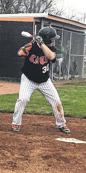Caleb West waits for a pitch on Wednesday at Whiteoak High School where the Wildcats took on the West Union Dragons in SHAC baseball action.