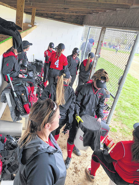 The Fairfield Lady Lions softball team looks on from the dugout between innings on Tuesday at West Union High School where they battled the Lady Dragons in SHAC competition.