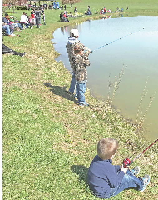 Some of the people who took part in Saturday's Family Fishing Day are pictured at Harmony Lake at Liberty Park in Hillsboro.